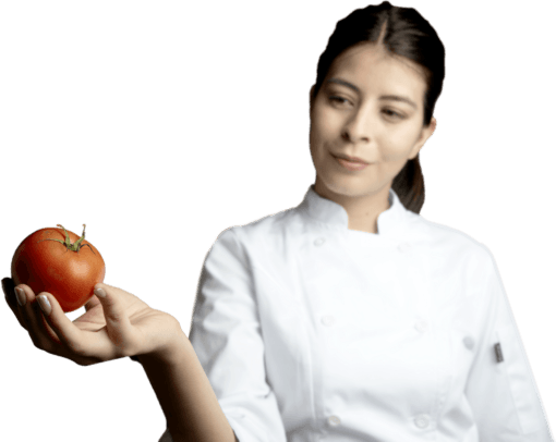 girl in chef uniform holding a tomato