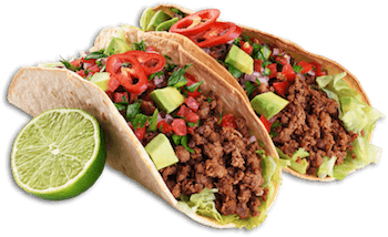 two tacos with grounded meat vegetables and a lime